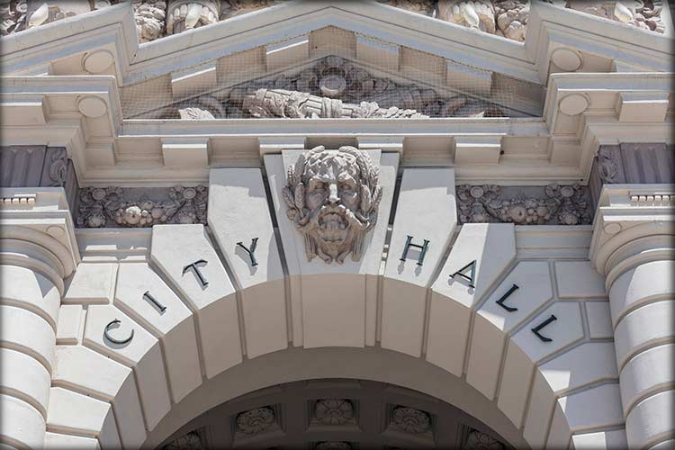 Photo showing the top of the entryway into a City Hall building