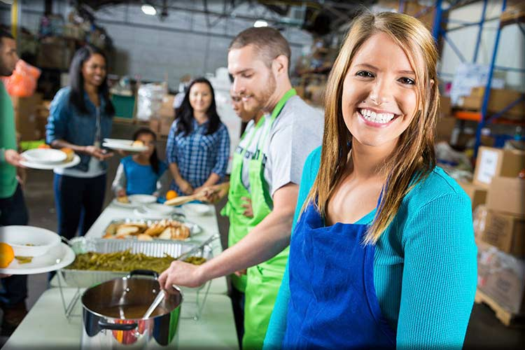 Volunteers work at a soup kitchen for community involvement