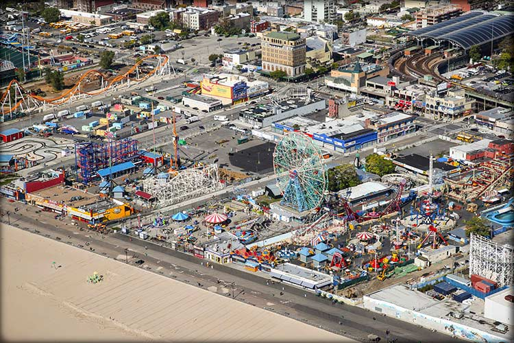 Photo of carnival setup on beachfront taken from overhead