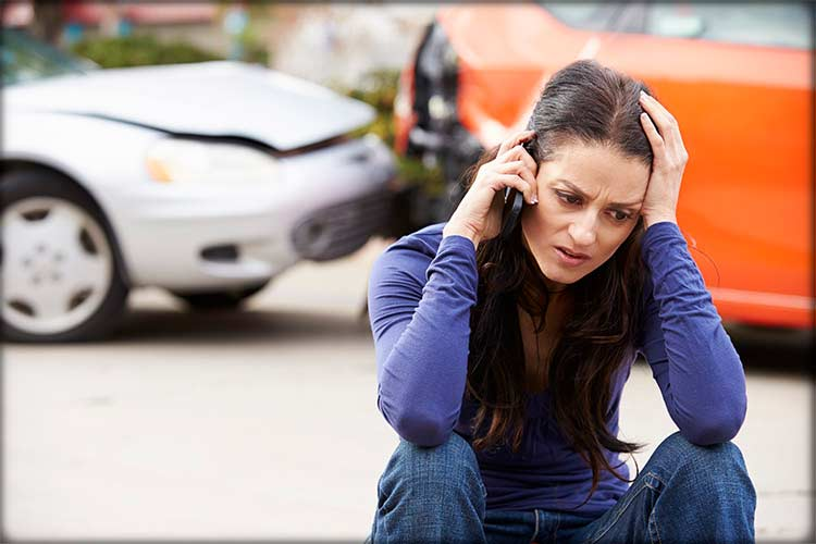 photo of girl on phone after car accident